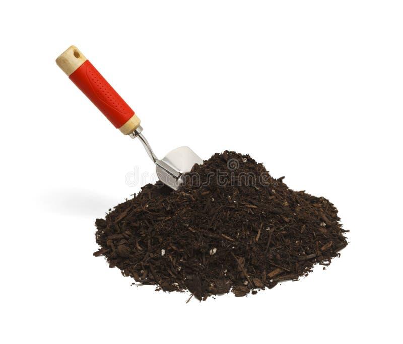 Shovel and Dirt. Garden Soil with Hand Shovel on White Background stock images