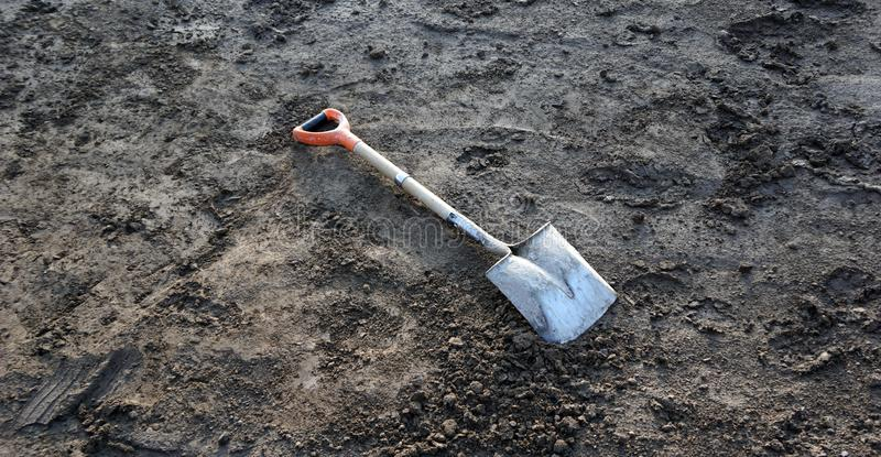 Shovel in the dirt royalty free stock photos
