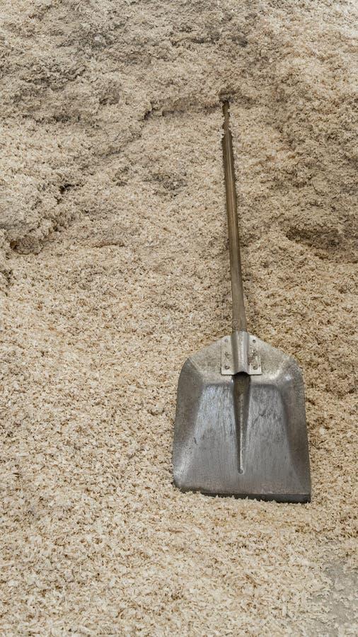 Shovel. Over pile of shavings stock image