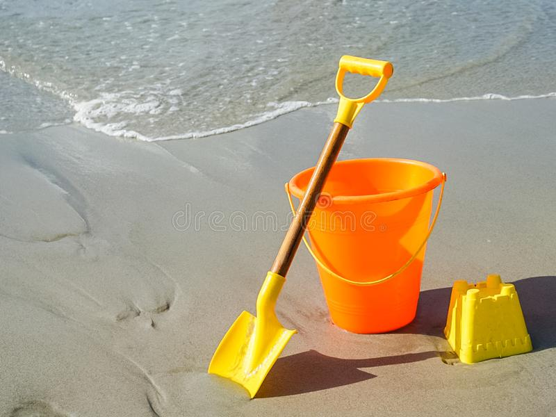 A Shovel and Pail on the Beach. Ready to build a sandcastle with this shovel and pail on the beach stock photo
