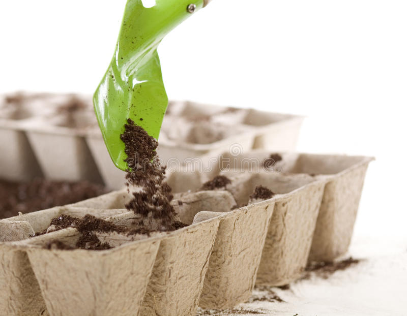 Shovel Placing Soil Into Eco-friendly Compost Pots Royalty Free Stock Photography
