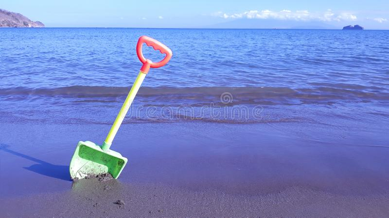 Shovel in the sand stock images