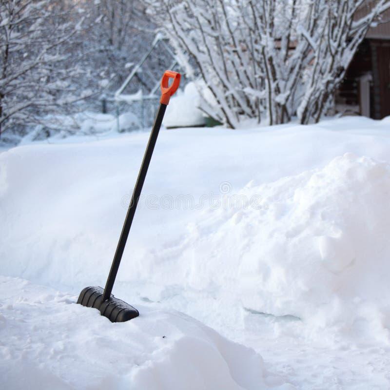 Shovel snow stock photography