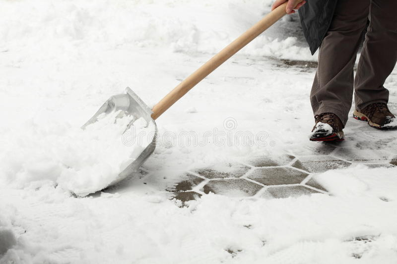 Shovel snow royalty free stock photography