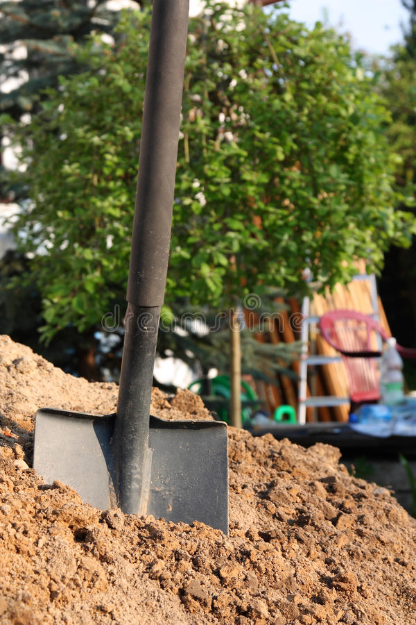 Shovel in the soil royalty free stock images