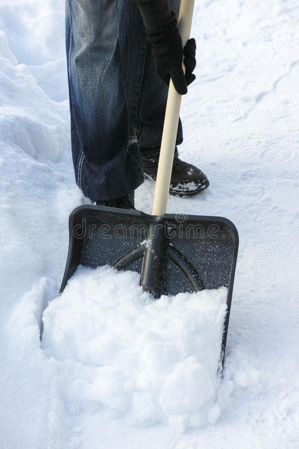 Shoveling snow royalty free stock images