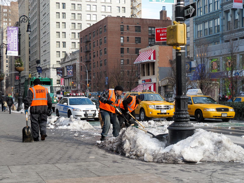 Shovelling snow on the streets royalty free stock photo