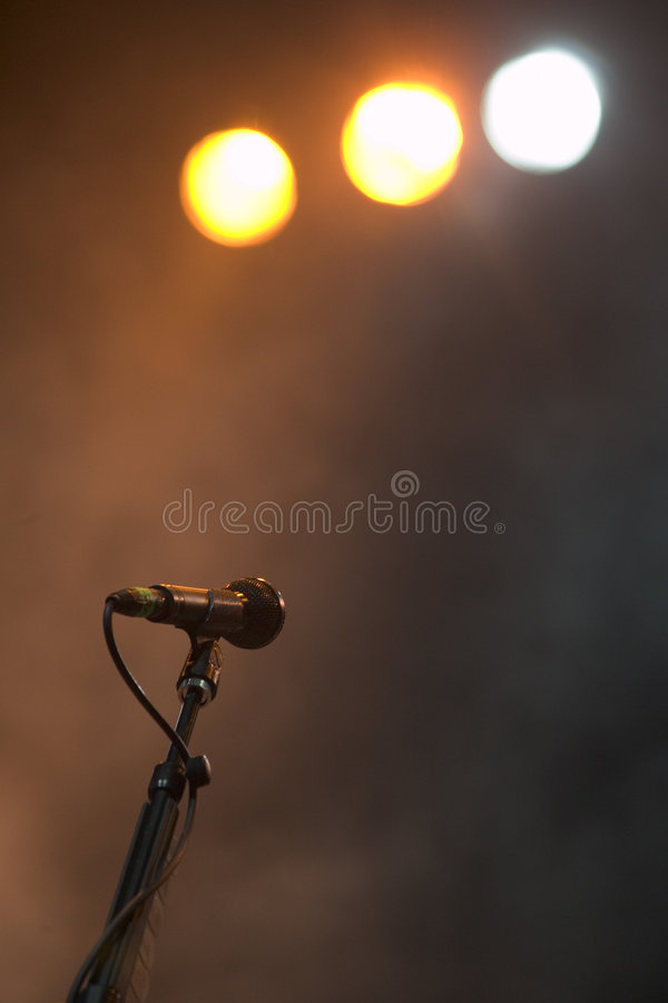 Before the Show. Isolated micRophone and stage lights in a misty atmosphere