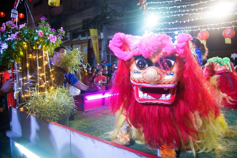 A show of Beijing Chinese lion dance on street at night in Chinese New Year festival days. stock image