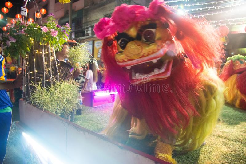 A show of Beijing Chinese lion dance on street at night in Chinese New Year festival days. royalty free stock images