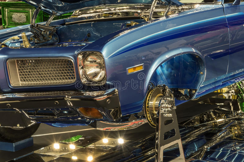 Show car front end. Picture of blue show car front end in display with lights and mirror royalty free stock photography