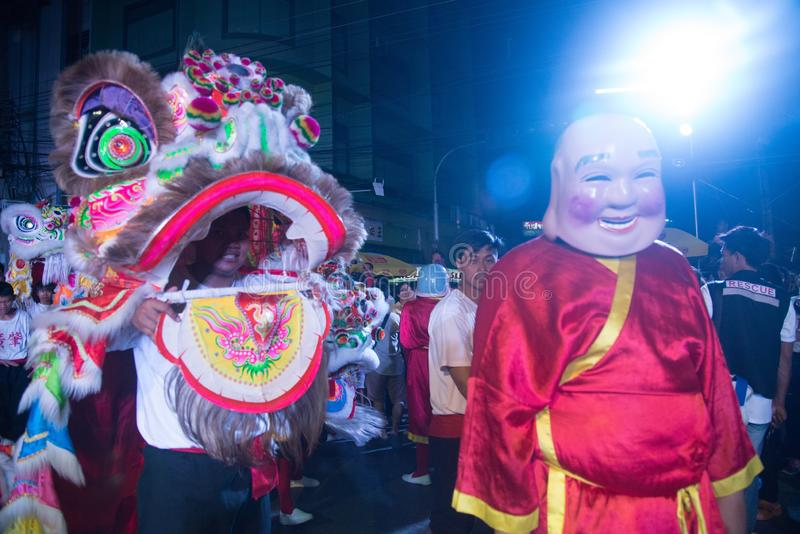 A show of Chinese lion dance on street at night in Chinese New Year festival days. stock photo