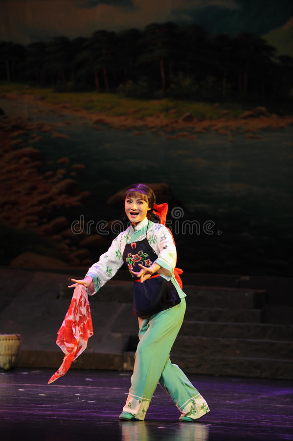 Show flower scarf- Jiangxi opera a steelyard. Jiangxi opera a steelyard is adapted from a true story: the last century fortys, the protagonists father runs an stock photo