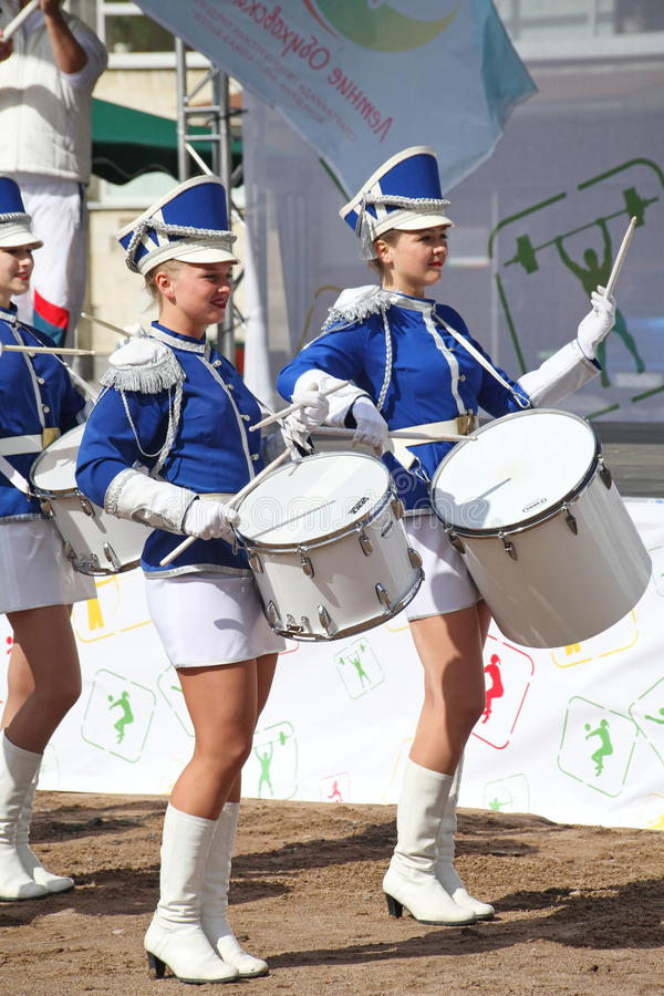 Show-group of drummers in blue uniform of the Royal lancers. Show-group of drummers Malaya Okhta is a group with powerful energy, gorgeous costumes and a live stock photo