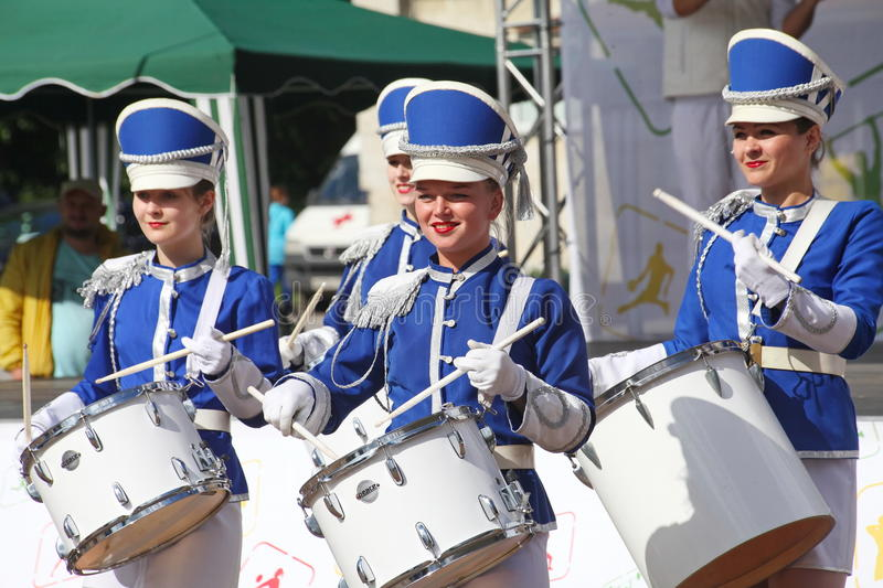 Show-group of drummers in blue uniform of the Royal lancers. Show-group of drummers Malaya Okhta is a group with powerful energy, gorgeous costumes and a live royalty free stock images