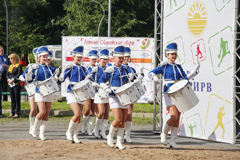 Show-group of drummers in blue uniform of the Royal lancers. Show-group of drummers Malaya Okhta is a group with powerful energy, gorgeous costumes and a live royalty free stock photos