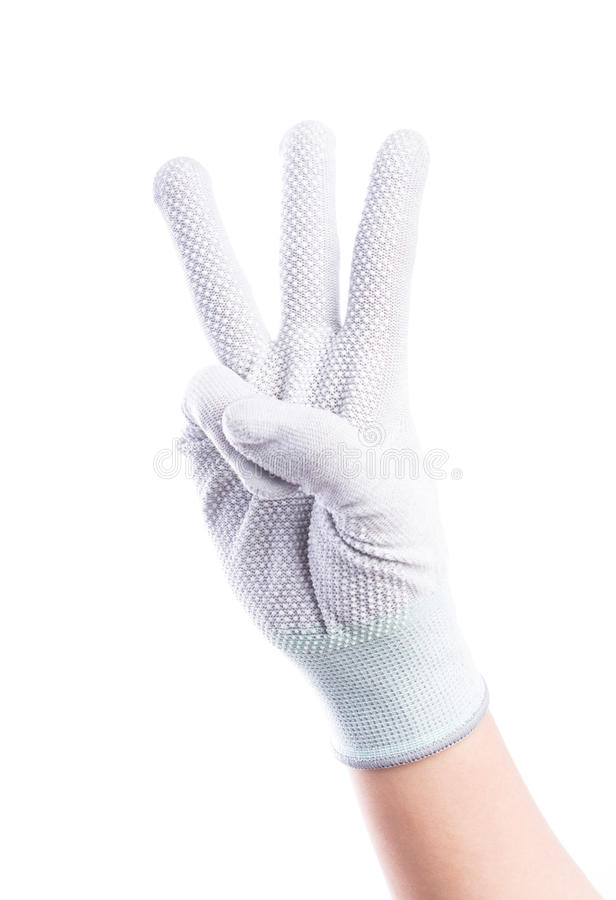 Show Hands three finger with cotton gloves royalty free stock image