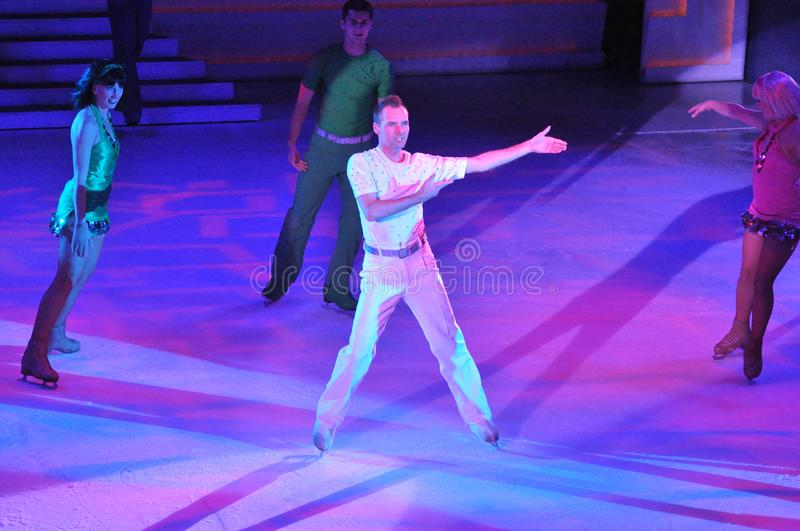 Show on ice. Professional sportsmans ice skaters performing in an ice show production onboard cruise ship Adventure of the Seas royalty free stock image