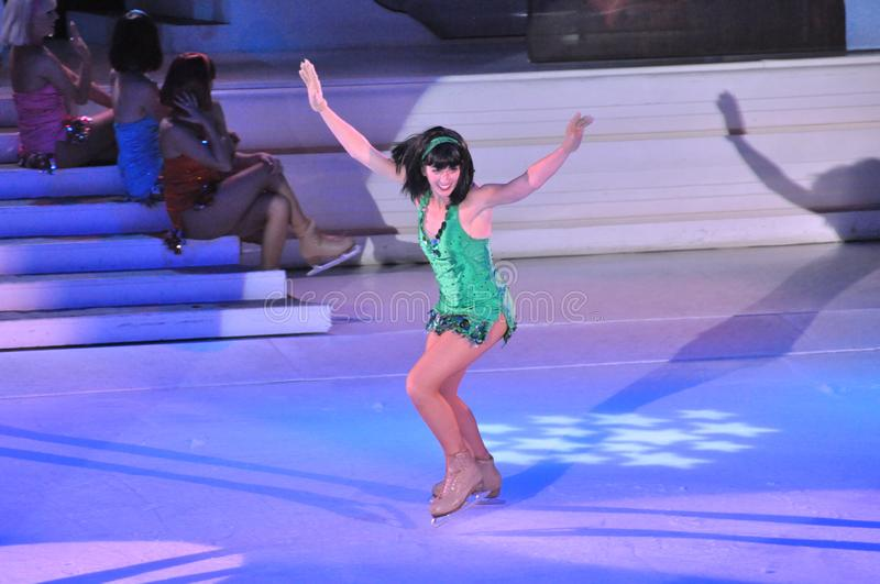 Show on ice. Professional sportsmans ice skaters performing in an ice show production onboard cruise ship Adventure of the Seas royalty free stock photography