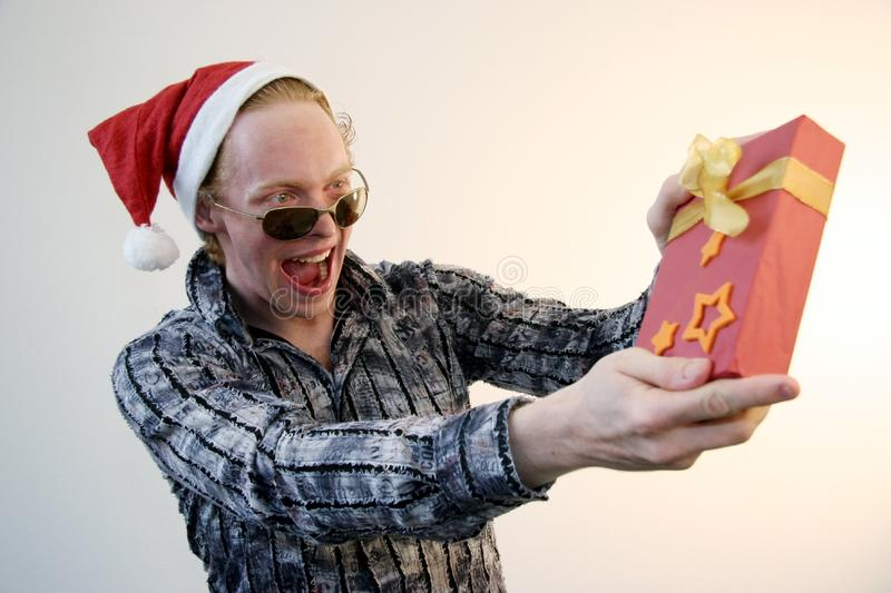 Download Show-off with xmas gift stock photo. Image of poser, christmas - 6793274