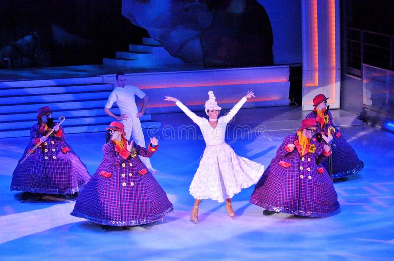 Show production on ice. Professional sportsmans ice skaters performing in an ice show production onboard cruise ship Adventure of the Seas stock images
