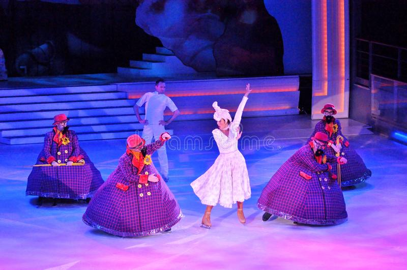 Show production on ice. Professional sportsmans ice skaters performing in an ice show production onboard cruise ship Adventure of the Seas royalty free stock image