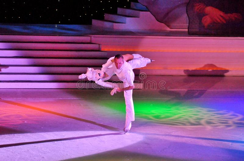 Show production on ice. Professional sportsmans ice skaters performing in an ice show production onboard cruise ship Adventure of the Seas royalty free stock images
