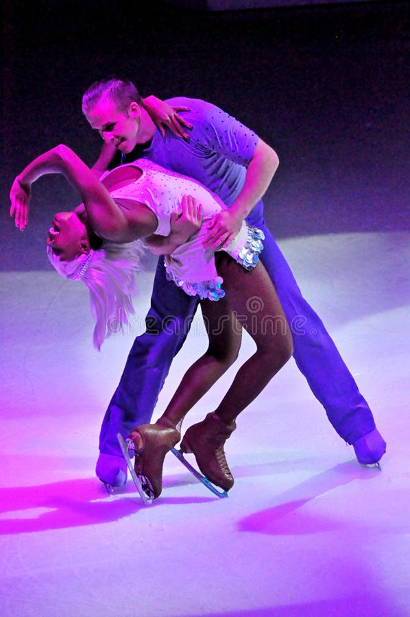 Show production on ice. Professional sportsmans ice skaters performing in an ice show production onboard cruise ship Adventure of the Seas stock photography