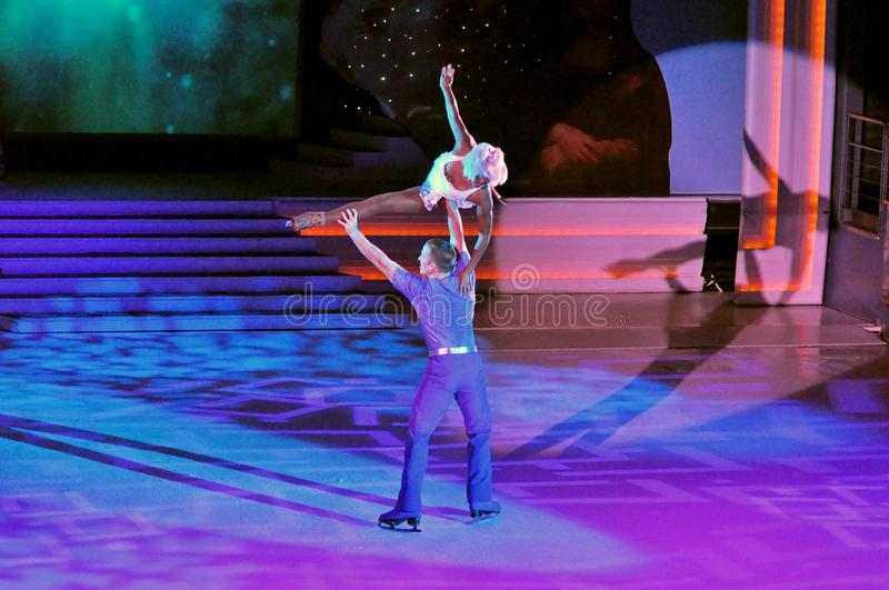 Show production on ice. Professional sportsmans ice skaters performing in an ice show production onboard cruise ship Adventure of the Seas stock image