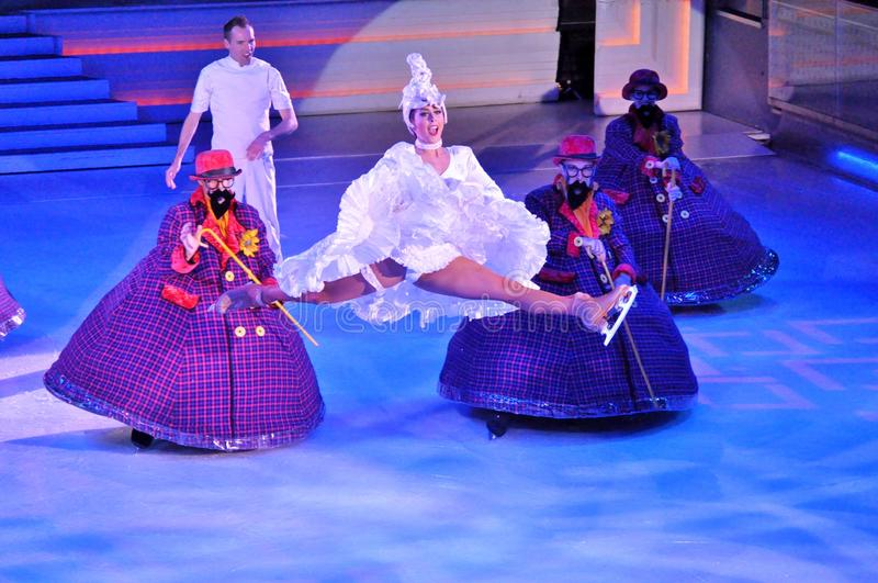 Show production on ice. Professional sportsmans ice skaters performing in an ice show production onboard cruise ship Adventure of the Seas stock photos