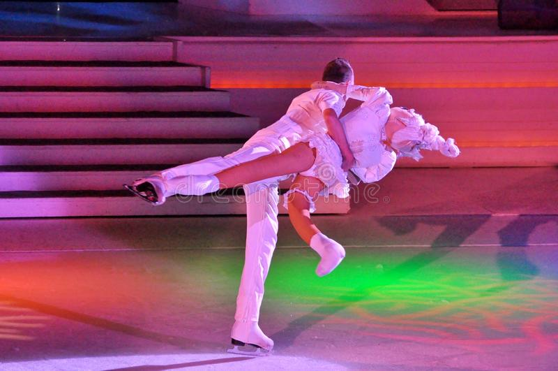Show production on ice. Professional sportsmans ice skaters performing in an ice show production onboard cruise ship Adventure of the Seas royalty free stock photo