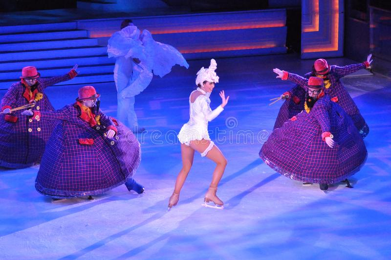 Show production on ice. Professional sportsmans ice skaters performing in an ice show production onboard cruise ship Adventure of the Seas royalty free stock photos