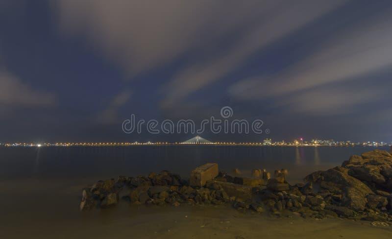 Show shutter Image of Bandra-worli Bridge taken from Shivaji Park Beach at Twilight in Mumbai,Maharashtra,India. Asia stock photos