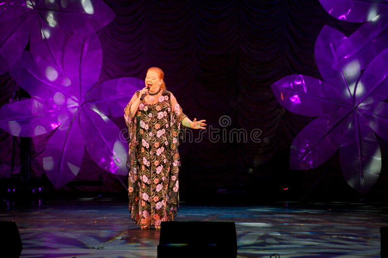 Show singer Lyudmila Senchina on the stage of in the house of culture named after Gorky. Day of older persons 01/10/2008. The entry, show singer Lyudmila royalty free stock photo