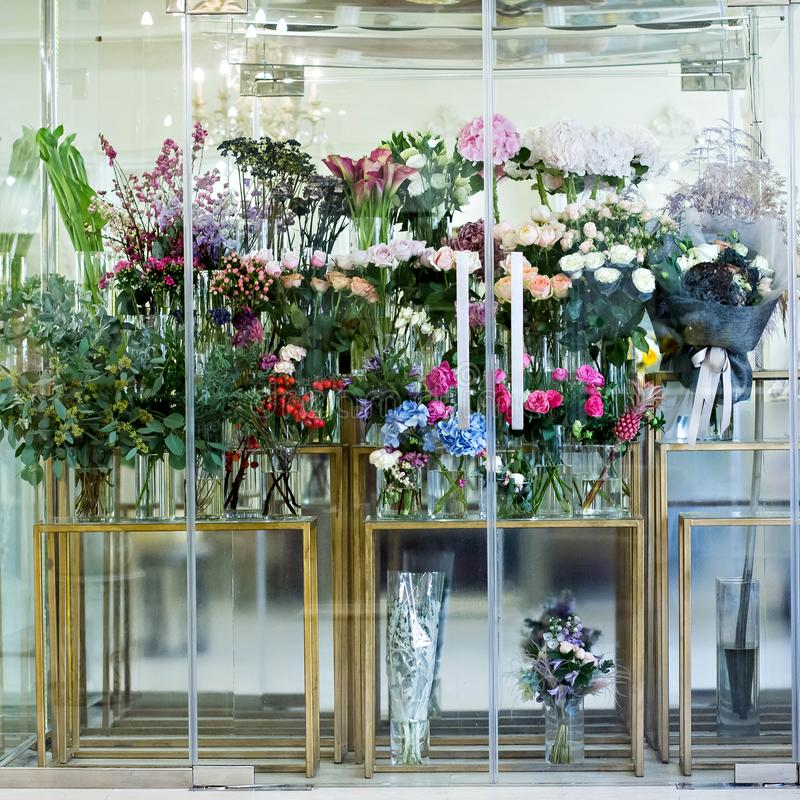 Showcase in the flower shop. Many bouquets of flowers stock image
