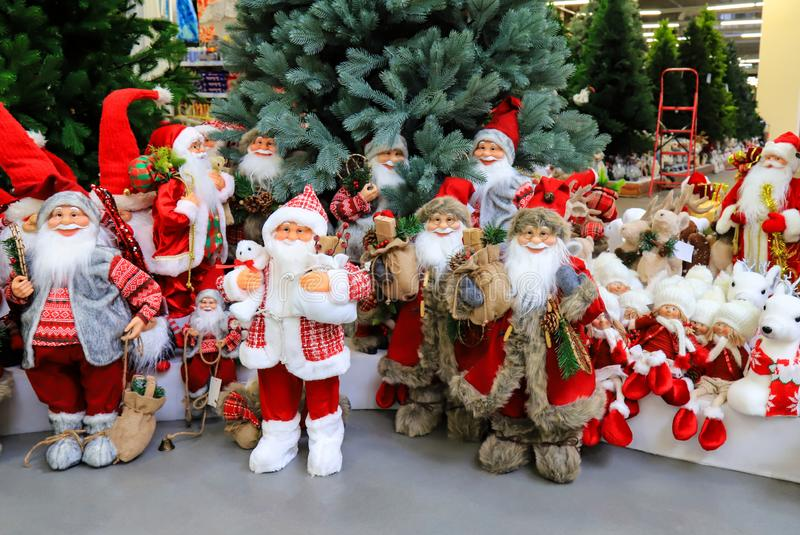 Showcase with Funny Santa Claus, Christmas and New Year toys and decoration. Positive emotions, joy. Festive winter trade, fair. In toy store, shopping royalty free stock photo