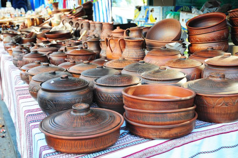 Showcase of Handmade Ukraine Ceramic Pottery in a Roadside Market with Ceramic Pots and Clay Plates Outdoors. Traditional Ceramic Jugs on Decorative Towel stock photos