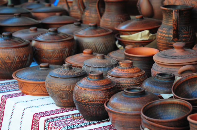 Showcase of Handmade Ukraine Ceramic Pottery in a Roadside Market with Ceramic Pots and Clay Plates Outdoors. Traditional Ceramic Jugs on Decorative Towel stock photography