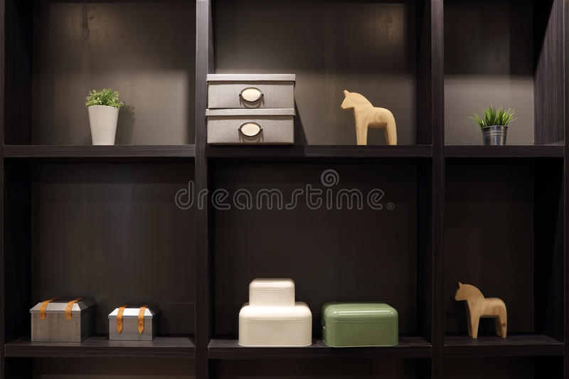Showcase of home decor object on shelves in modern living for Modern home decor objects