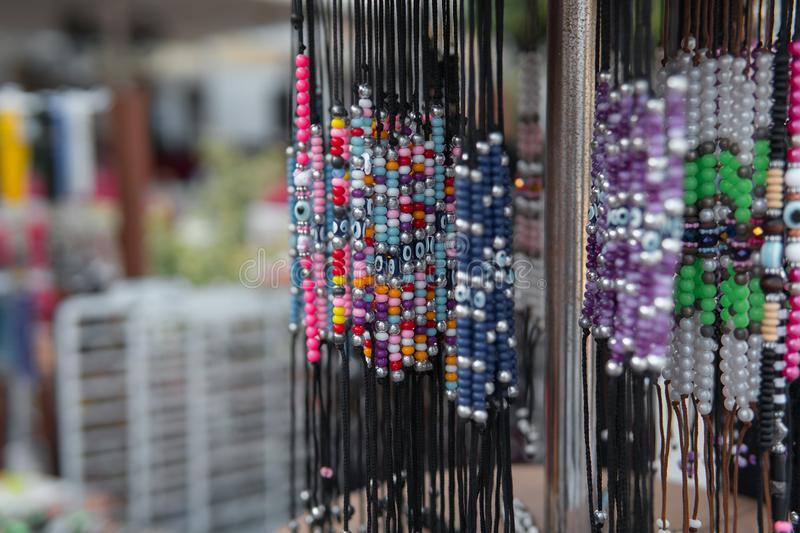 Showcase with keychains and trinkets. Gift market, nobody. Showcase with keychains and trinkets. Gift market, nobody stock images