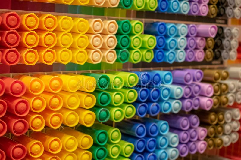 Showcase with bright colorful markers royalty free stock images