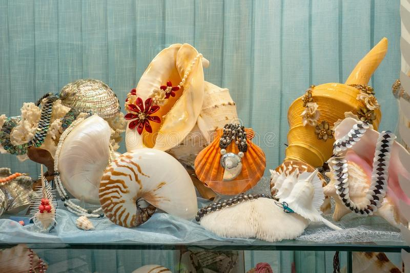 Showcase with products from sea shells and mother-of-pearl. Beads bracelets and earrings are sold in the store royalty free stock photo