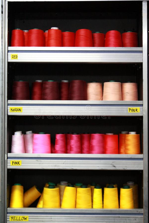 Showcase spools of thread in a haberdashery shop stock image