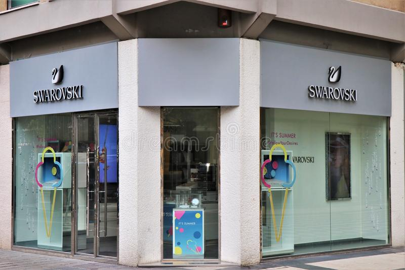 Sign and showcase of a Swarovsky store. stock photos