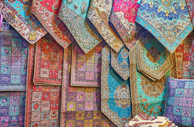 Persian tapestries in Vakil Bazaar of Shiraz, Iran. The showcase of Vakil Bazaar store with wide range of silk tapestries with complex Persian patterns, Shiraz stock images