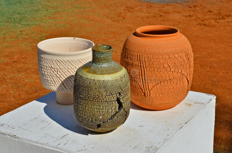 Showed colored earthenwear. Unwanted flaw earthenware show on the stand in park royalty free stock image