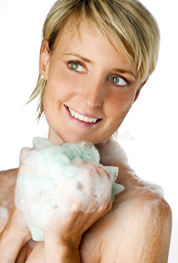 Shower. Young blond woman under shower isolated close up stock photos