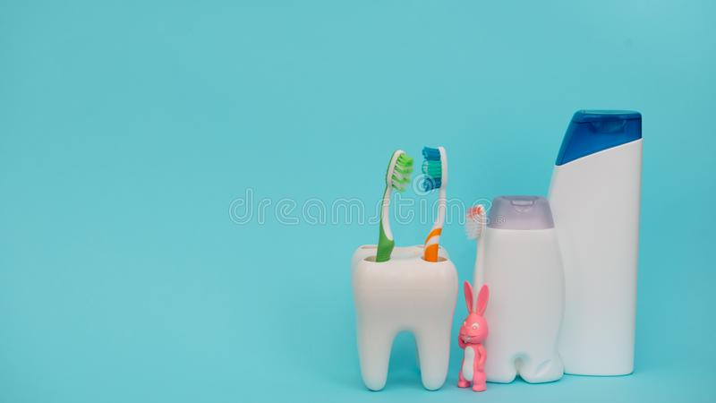 Shower accessories on a colored background. bathroom setting on blue background. means of body hygiene stock photos