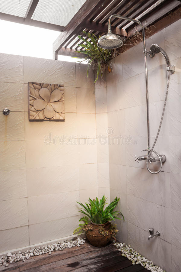 Shower in bright bathroom interior of wooden roof royalty free stock photo