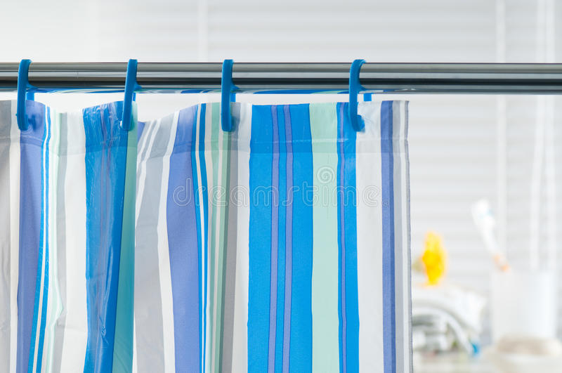 Shower curtain. Blue shower curtain in the bathroom stock images